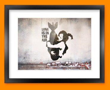 Banksy Bomb Hug Framed Print