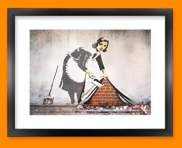 Banksy Street Maid Framed Print