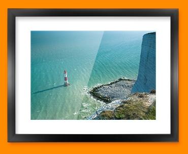 Light House Cliffs Framed Print