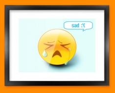 Sad Emoticon Framed Print