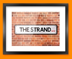 The Strand UK Street Sign Framed Print